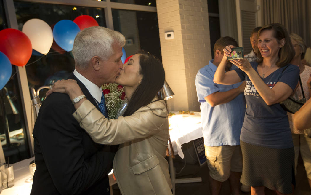 Las Vegas city council candidate Col. Steve Seroka shares a kiss with his wife Nancy Wong during his election result party at Andiron Steak and Sea in Las Vegas on Tuesday, June 13, 2017. Richard  ...