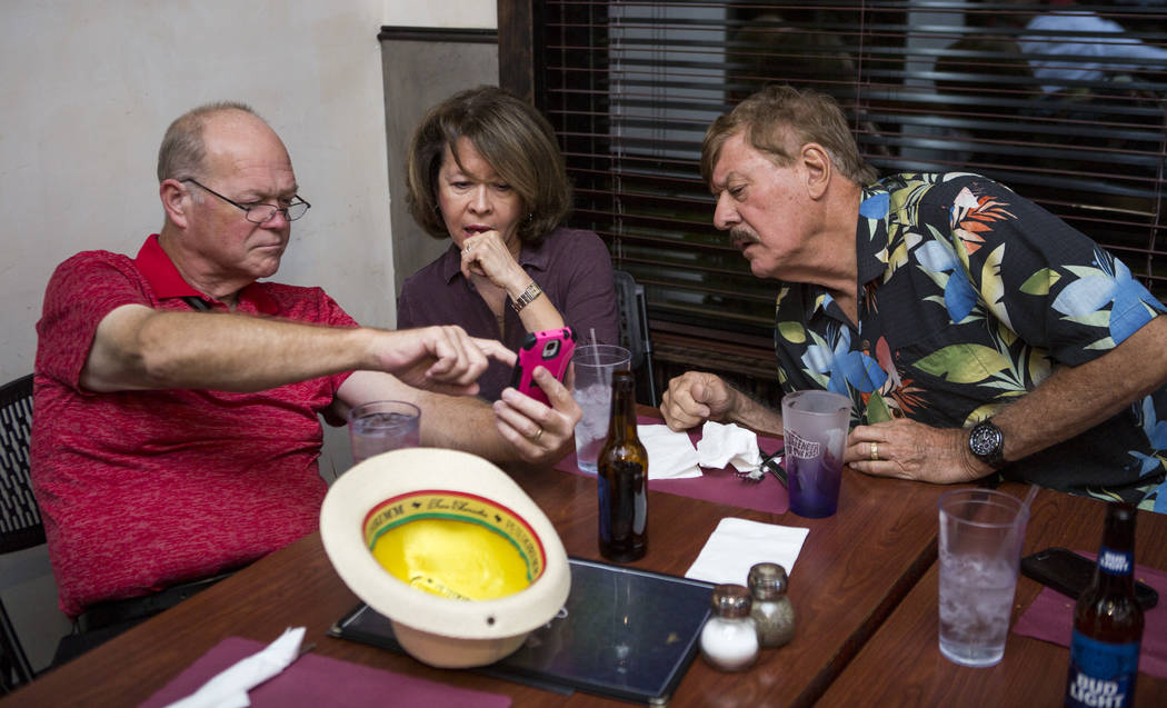 Councilman Bob Beers looks at election results with friends Martha and Mike Kimpel at Lola's - A Louisiana Kitchen in Summerlin on Tuesday, June 13, 2017.  Patrick Connolly Las Vegas Review-Journa ...