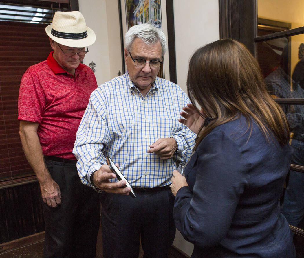 Councilman Bob Beers, left, and his wife Sarah looks at election results with his campaign manager, Steve Forsythe, center, at Lola's - A Louisiana Kitchen in Summerlin on Tuesday, June 13, 2017.  ...