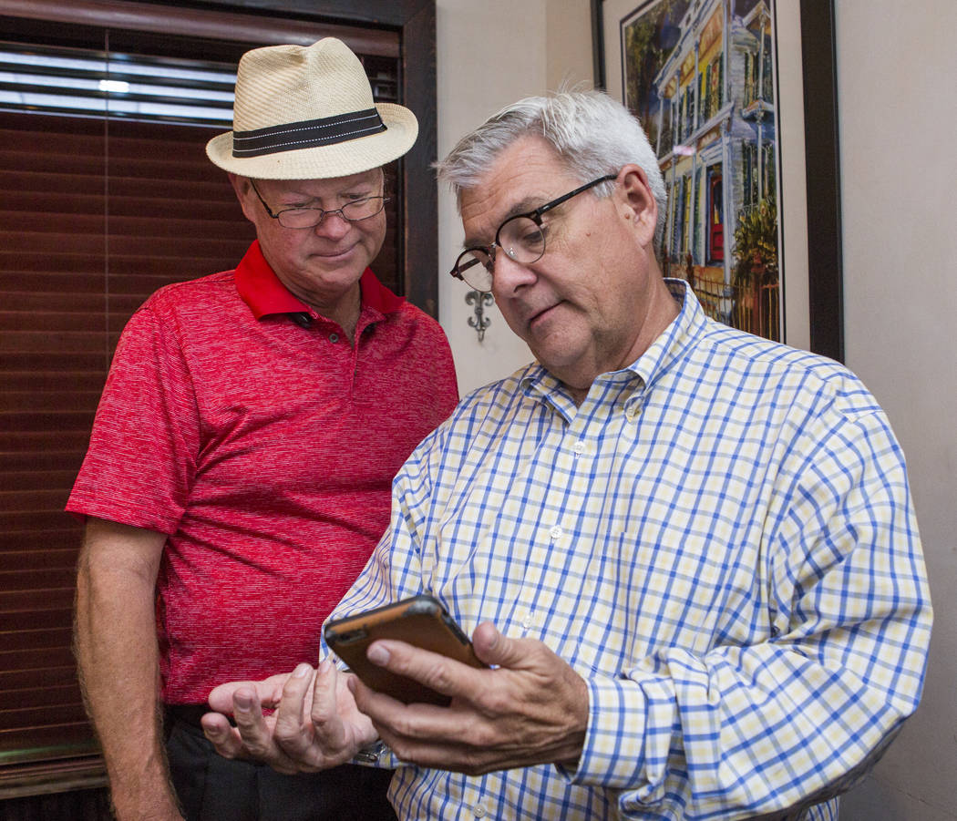 Councilman Bob Beers, left, looks at election results with his campaign manager, Steve Forsythe, at Lola's - A Louisiana Kitchen in Summerlin on Tuesday, June 13, 2017.  Patrick Connolly Las Vegas ...