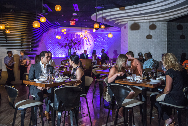 Customers dine inside STK at the Cosmopolitan hotel-casino in Las Vegas on Friday, June 12, 2015. (Martin S. Fuentes/Las Vegas Review-Journal)