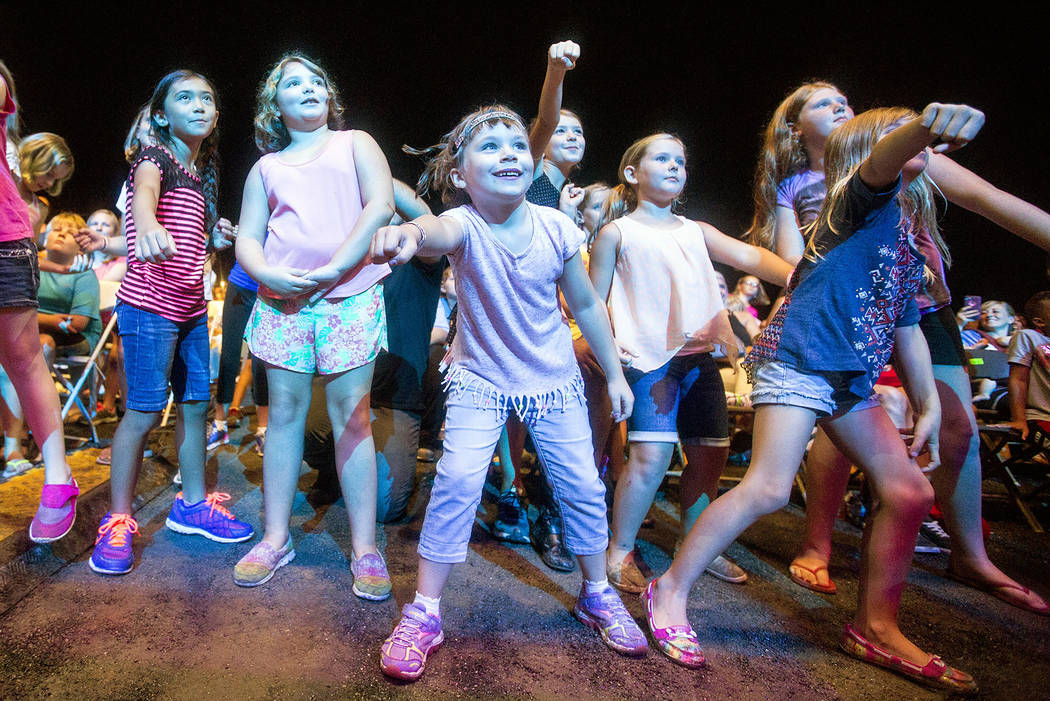 Children in the front row dance as the Kidz Bop Kids perform during Wednesday night's concert at the Rockingham County Fair in Harrisonburg, Va., Aug. 17, 2016. (Daniel Lin/Daily News-Record via AP)