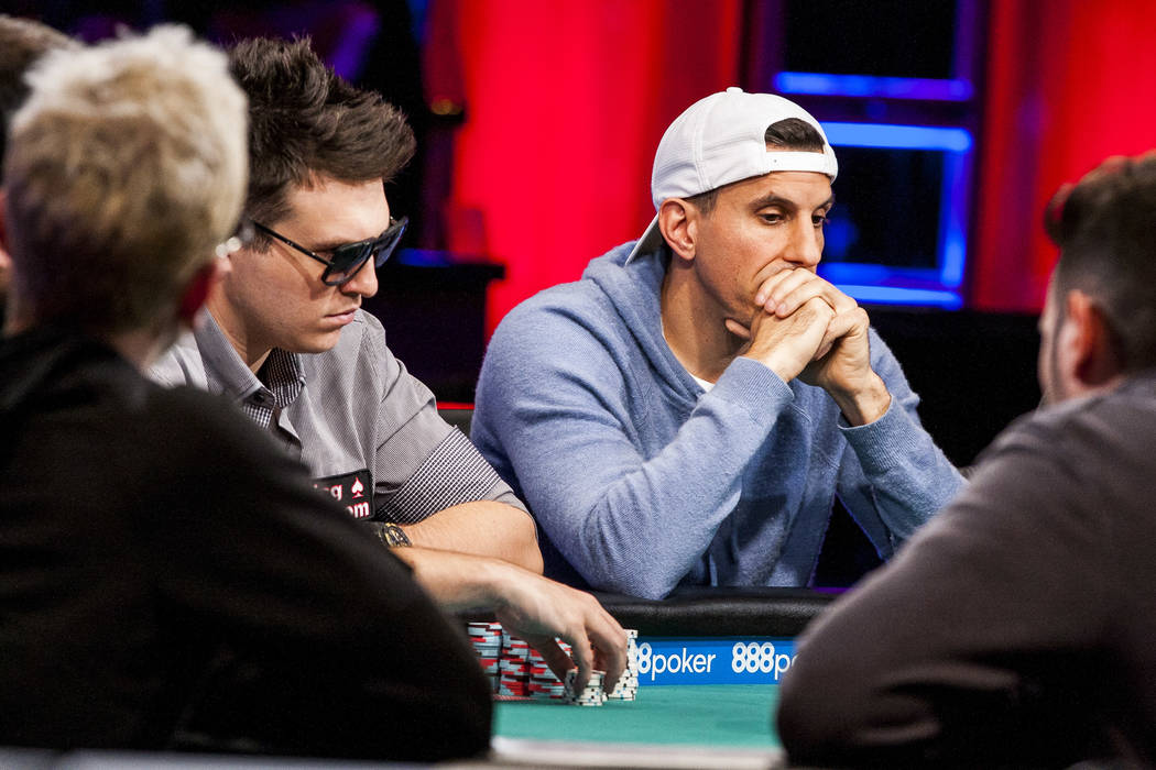 Haralabos Voulgaris, right, and Doug Polk, left, compete in the $111,111 buy-in High Roller for One Drop No-Limit Hold'em event at the World Series of Poker at the Rio Convention Center on Monday, ...