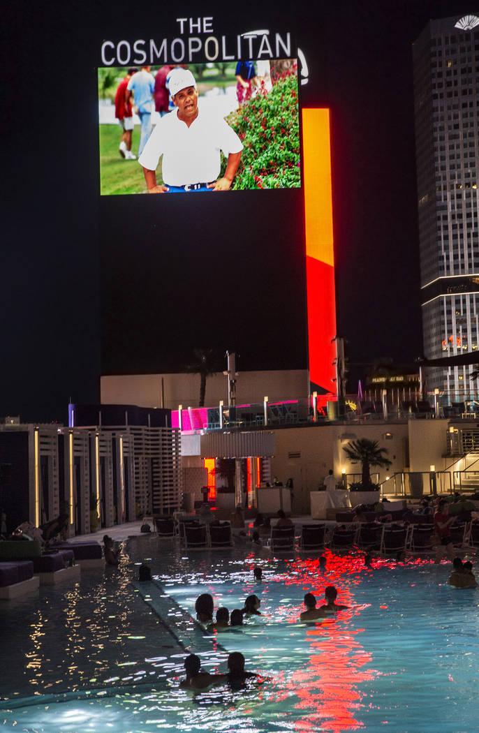 "Poolgoers enjoy a showing of ""Happy Gilmore"" during Dive In Movies at Boulevard Pool at the Cosmopolitan Las Vegas on Monday, June 5, 2017. (Benjamin Hager Las Vegas Review-Journal) @benjaminhphoto"