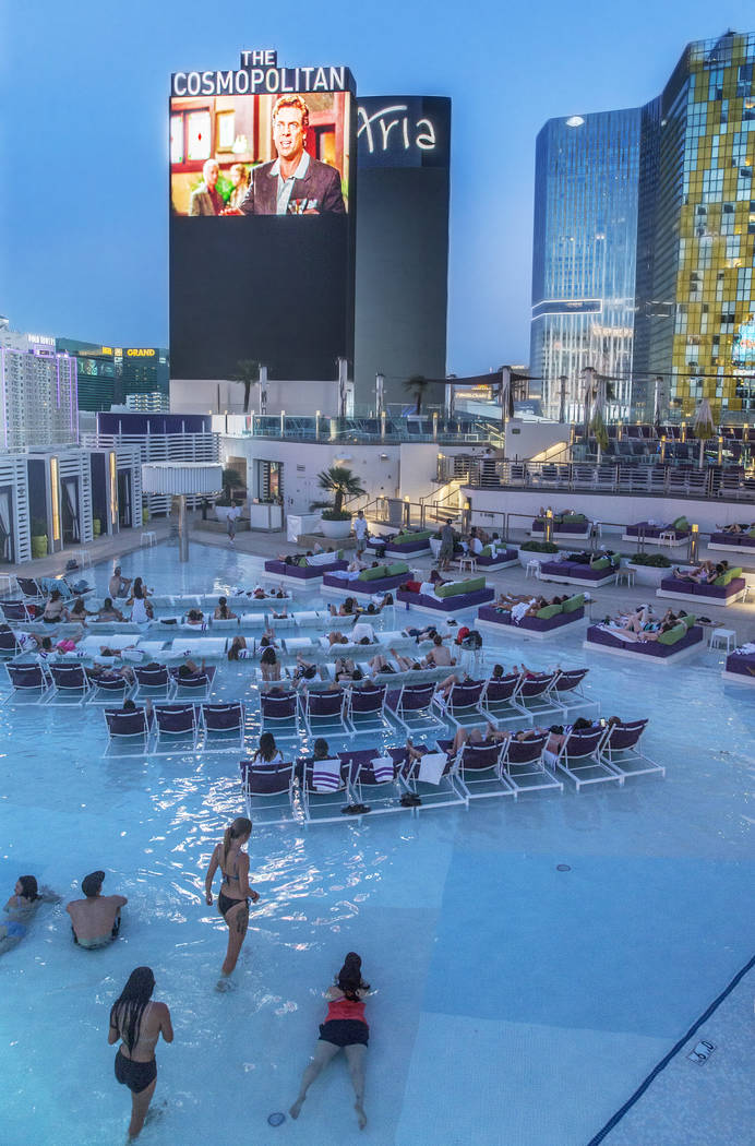 "Poolgoers enjoy a showing of ""Happy Gilmore"" during Dive In Movies at Boulevard Pool at the Cosmopolitan Las Vegas on Monday, June 5, 2017. (Benjamin Hager Las Vegas Review-Journal) @benjaminhphoto"