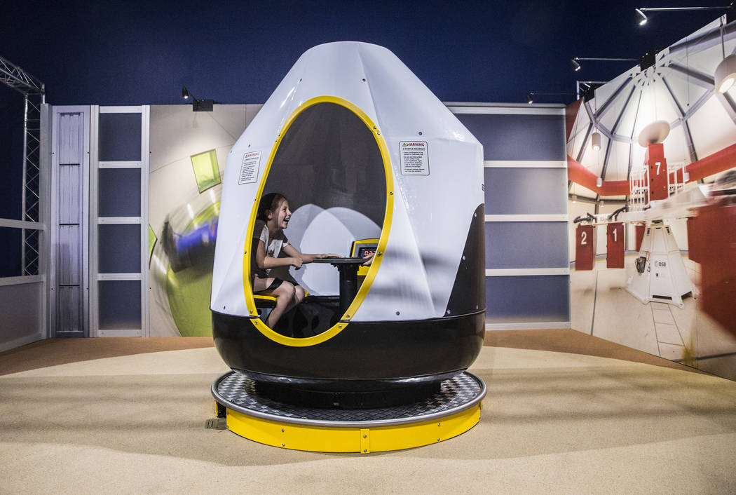 "Isabelle Grady explores a g-force training capsule during a special members viewing day at the new ""Astronaut"" exhibit on Sunday, June 11, 2017, at Springs Preserve, in Las Vegas ..."