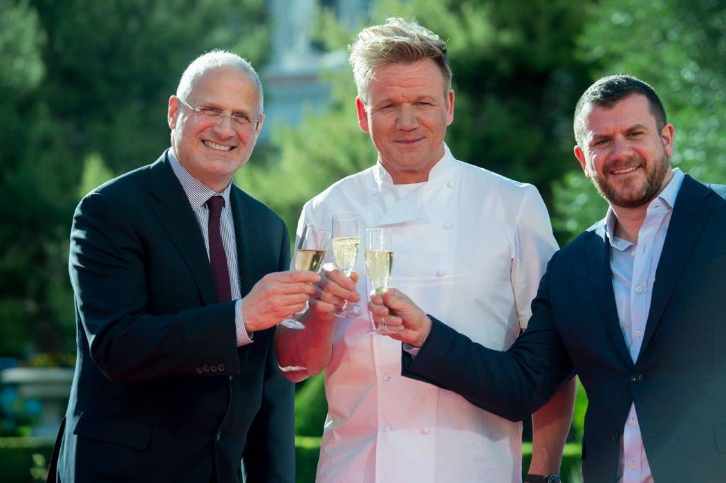 Gordon Ramsay, center, announces his new theatrical dining restaurant Hell's Kitchen at Caesars Palace on Friday, April 28, 2017, in Las Vegas. (Tom Donoghue)