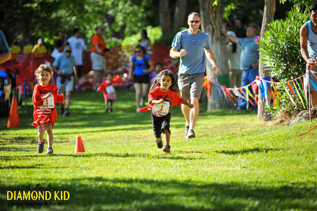 Children compete in the 2015 Diamond Kid Jr. Triathlon and Fun Run in Blue Diamond. (Matt Carter/LV Action Images)