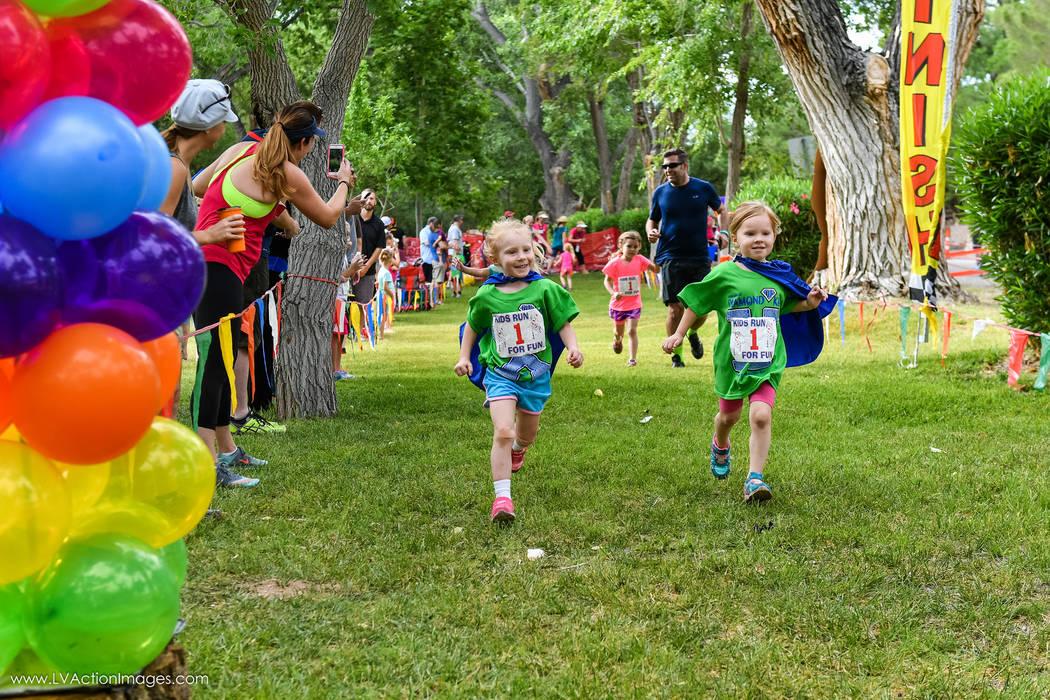 Children run past the finish line at the 2016 Diamond Kid Jr. Triathlon and Fun Run in Blue Diamond. (Matt Carter/LV Action Images)