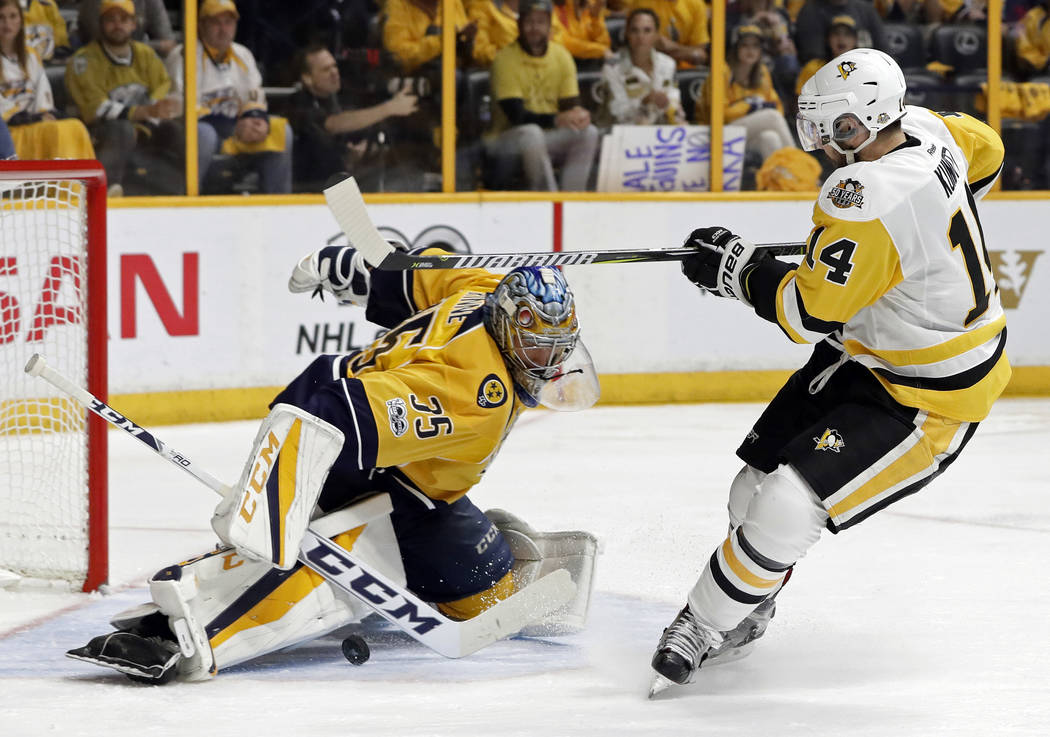 Nashville Predators goalie Pekka Rinne (35), of Finland, stops a shot by Pittsburgh Penguins left wing Chris Kunitz (14) during the second period in Game 4 of the NHL hockey Stanley Cup Finals Mon ...