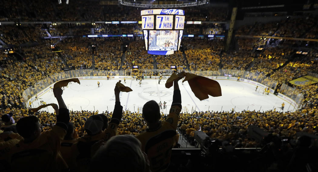 Nashville Predators fans cheer in the final moments of the third period in Game 4 of the NHL hockey Stanley Cup Finals against the Pittsburgh Penguins Monday, June 5, 2017, in Nashville, Tenn. The ...