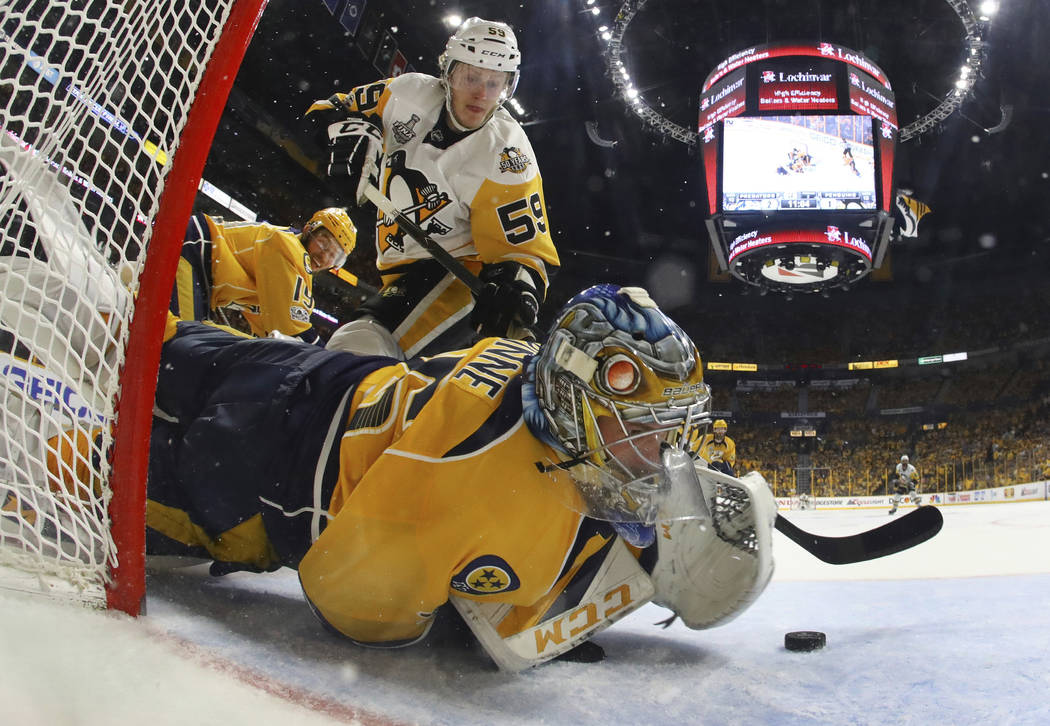 Nashville Predators goalie Pekka Rinne (35), of Finland, stops a shot by Pittsburgh Penguins center Jake Guentzel (59) during the second period in Game 4 of the NHL hockey Stanley Cup Final Monday ...