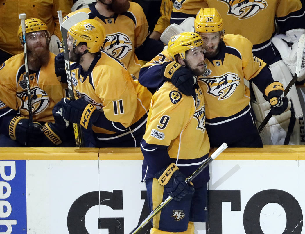 Nashville Predators left wing Filip Forsberg (9), of Sweden, is congratulated by Frederick Gaudreau (32) after Forsberg scored an empty net goal against the Pittsburgh Penguins during the third pe ...
