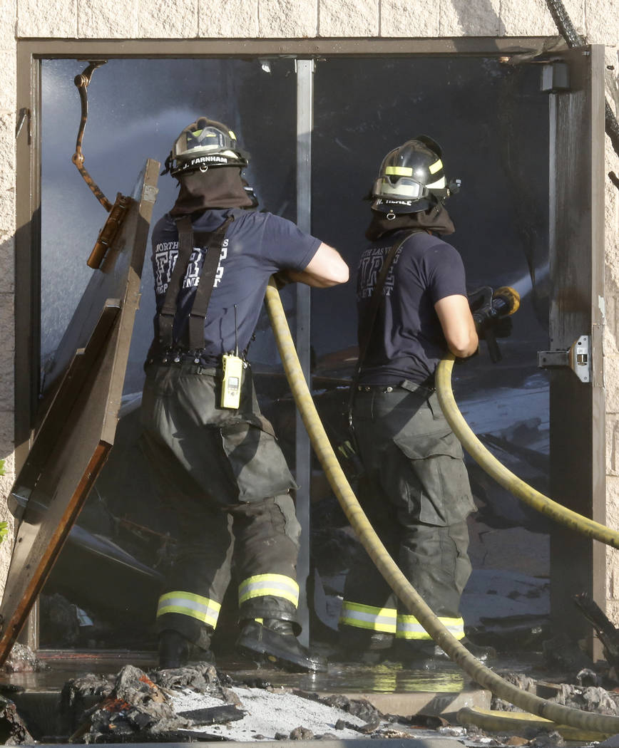 North Las Vegas firefighters spray water on Zion United Methodist Church, 2108 Revere St., which was reported on fire about 1 a.m. Tuesday, June 6, 2017. (Bizuayehu Tesfaye/Las Vegas Review-Journa ...