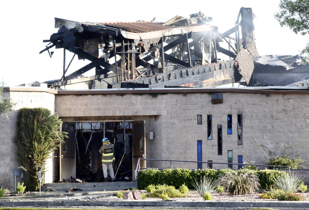 An agent with the Bureau of Alcohol, Tobacco, Firearms and Explosives investigates a fire at Zion United Methodist Church, 2108 Revere St., on Tuesday, June 6, 2017. (Bizuayehu Tesfaye/Las Vegas R ...