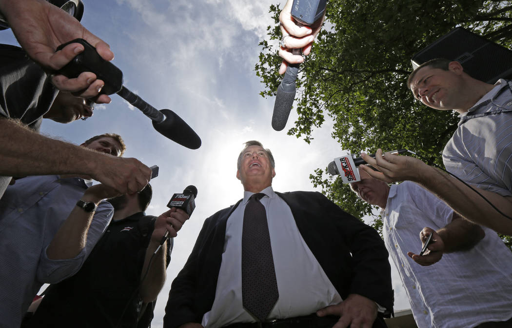 Tim Leiweke, center, CEO of the Oak View Group, talks to reporters following a news conference, Wednesday, June 7, 2017, in front of KeyArena in Seattle. Seattle Mayor Ed Murray said Wednesday tha ...