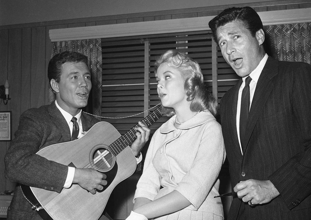 "Actors Roger Smith, left, Carolyn Komant and Efrem Zimbalist Jr., tune up for their parts in the TV series ""77 Sunset Strip,"" in Los Angeles, Feb. 15, 1961. Smith died at a Los Angeles hospital on ..."