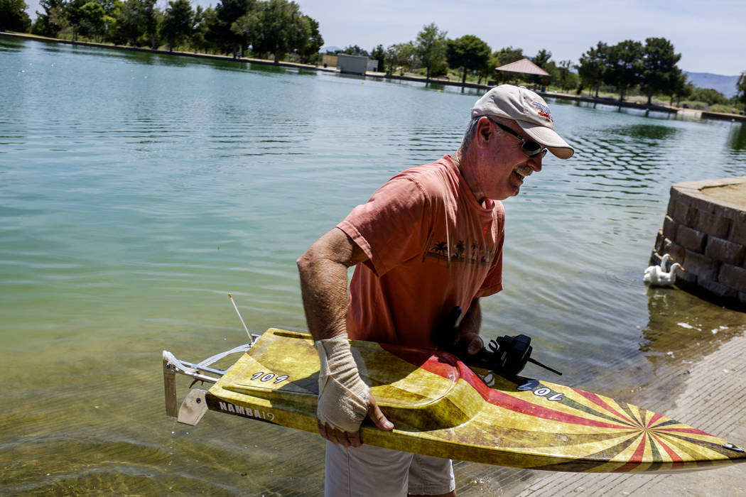 Mark Ferreira takes his radio-controlled boat out of the water at Sunset Park on Tuesday, June 6, 2017. Ferreira has raced RC boats for 25 years and won a national championship in 1998. (Patrick C ...