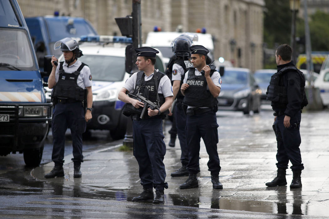 Police officers seal off the access to Notre Dame cathedral in Paris, France, Tuesday, June 6, 2017. Paris police say an unidentified assailant has attacked a police officer near the Notre Dame Ca ...