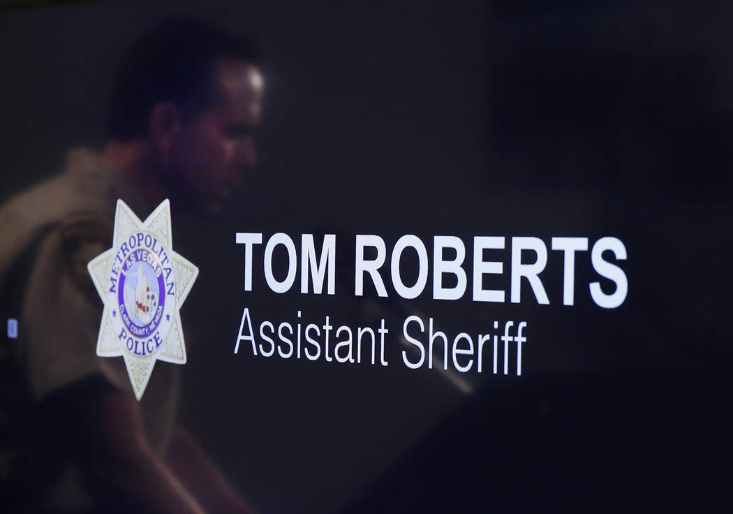 Assistant Sheriff Tom Roberts reflected in a television screen as he speaks with the press Tuesday, June 6, 2017 about an officer involved shooting of a man that occurred on June 1, 2017. Bizuayeh ...