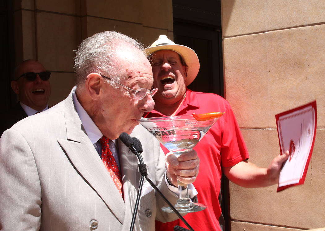 The Mob Museum employee Greg Lamb Former, right, reacts as former Las Vegas Mayor Oscar Goodman toasts with his signature, oversized gin martini, after presenting the 2017 Hospitality Hero award t ...