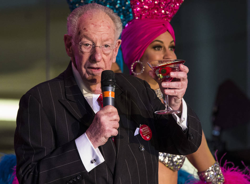 Former Las Vegas Mayor Oscar Goodman holds a drink during a celebration of tourism hosted by the Las Vegas Convention and Visitors Authority at the Fashion Show mall in Las Vegas on Tuesday, May 9 ...