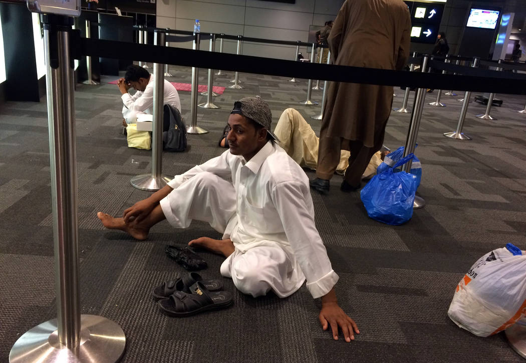 Passengers of canceled flights wait in Hamad International Airport (HIA) in Doha, Qatar, Monday, June 5, 2017. Saudi Arabia and other Arab powers severed diplomatic ties Monday with Qatar and move ...