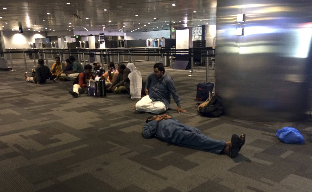 Passengers of cancelled flights wait in Hamad International Airport (HIA) in Doha, Qatar, Monday, June 5, 2017. Saudi Arabia and other Arab powers severed diplomatic ties Monday with Qatar and mov ...
