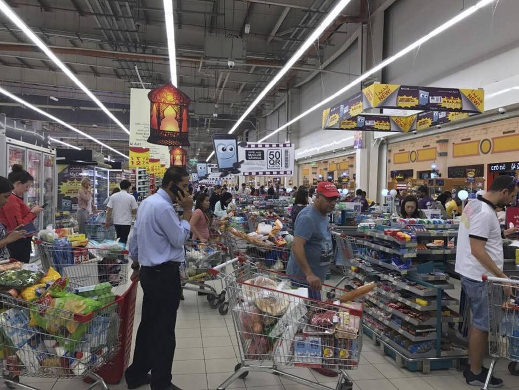 In this photo provided by Doha News, shoppers stock up on supplies at a supermarket in Doha, Qatar on Monday, June 5, 2017 after Saudi Arabia closed its land border with Qatar, through which the t ...