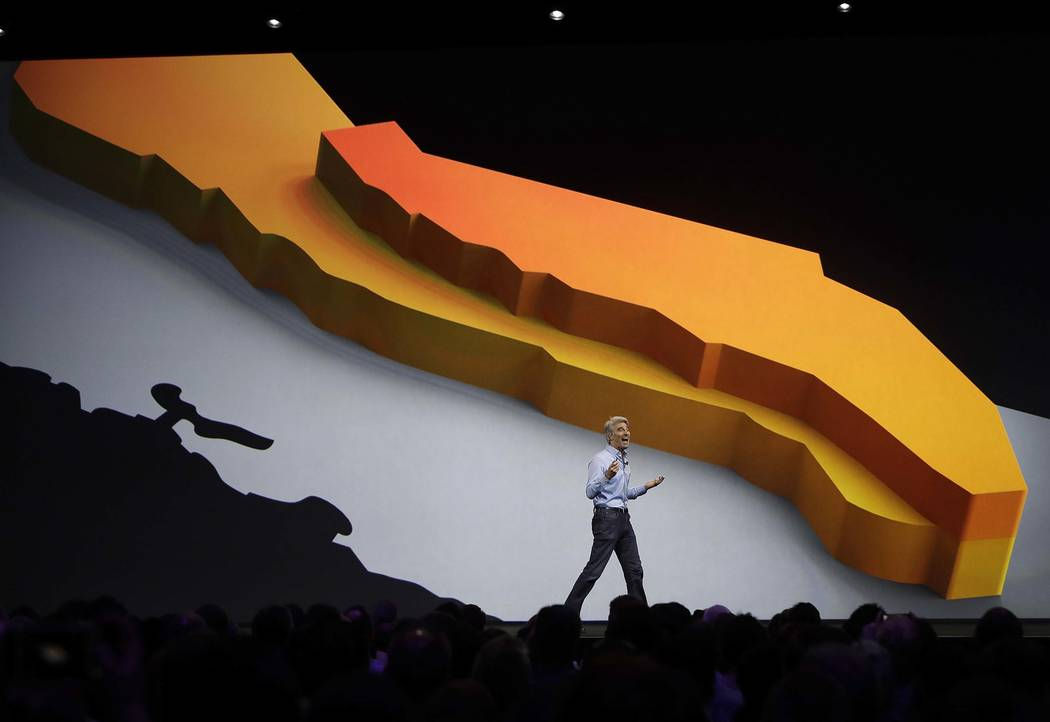 Craig Federighi, Apple's senior vice president of software engineering, speaks during an announcement of new products at the Apple Worldwide Developers Conference in San Jose, Calif., Monday, June ...