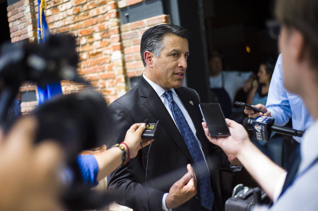 Gov. Brian Sandoval talks with reporters at The Union restaurant and brewery in Carson City on Monday, June 5, 2017. (Chase Stevens Las Vegas Review-Journal) @csstevensphoto