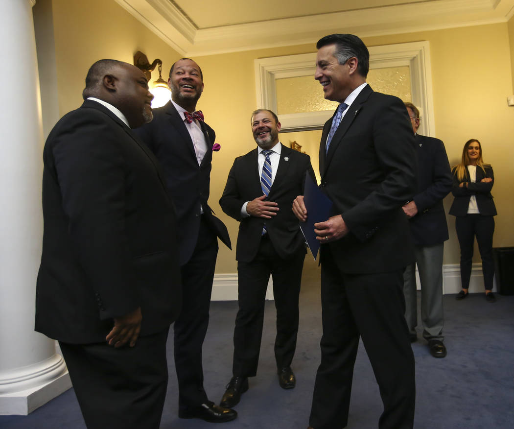 Gov. Brian Sandoval, right, talks with, from left, Assembly Speaker Jason Frierson, D-Las Vegas, Senate Majority Leader Aaron Ford, D-Las Vegas, and Assembly Minority Floor Leader Paul Anderson, R ...