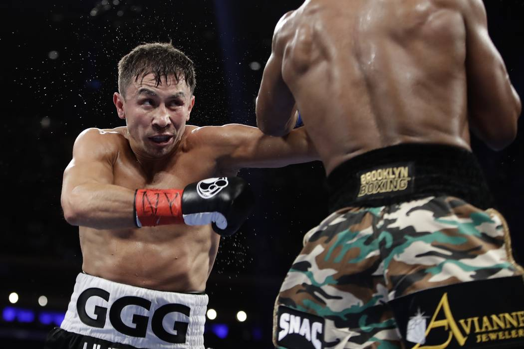 Gennady Golovkin, of Kazakhstan, fights Daniel Jacobs during the third round of a middleweight boxing match early Sunday, March 19, 2017, in New York. Golovkin won the fight. (AP Photo/Frank Frank ...