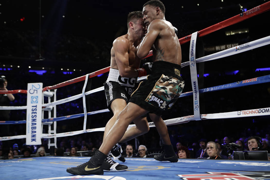 Gennady Golovkin, of Kazakhstan, left, knocks down Daniel Jacobs during the fourth round of a middleweight boxing match early Sunday, March 17, 2017, in New York. Golovkin won the fight. (AP Photo ...