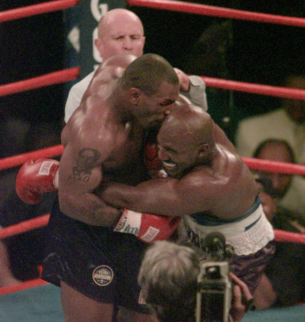 FILE -- This is a June 28, 1997, file photo showing Mike Tyson biting into the ear of Evander Holyfield in the third round of their WBA heavyweight bout in Las Vegas. Tyson and Holyfield are expec ...