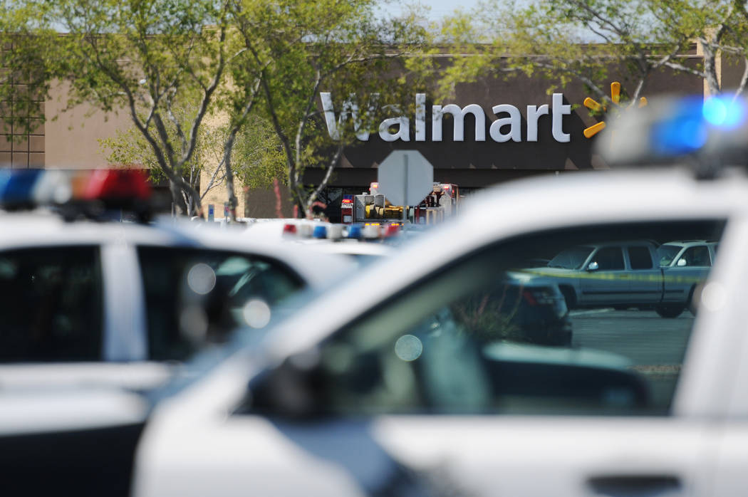 The scene at Walmart near Nellis Boulevard and Stewart Avenue in Las Vegas where two people were killed after fatally shooting two police officers on Sunday, June 8, 2014. (Erik Verduzco/Las Vegas ...