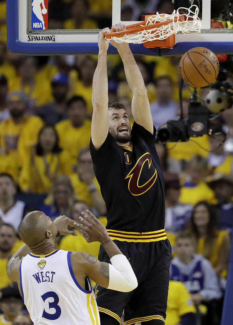 Cleveland Cavaliers forward Kevin Love (0) dunks over Golden State Warriors forward David West (3) during the first half of Game 2 of basketball's NBA Finals in Oakland, Calif., Sunday, June 4, 20 ...