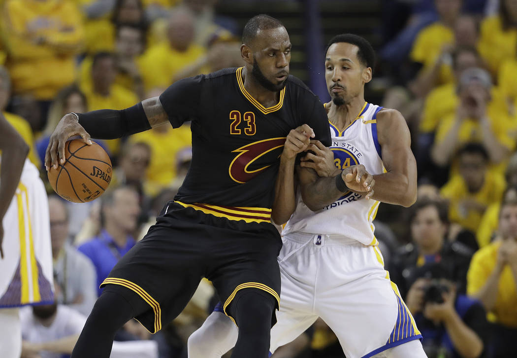 Cleveland Cavaliers forward LeBron James (23) drives on Golden State Warriors guard Shaun Livingston during the first half of Game 2 of basketball's NBA Finals in Oakland, Calif., Sunday, June 4,  ...