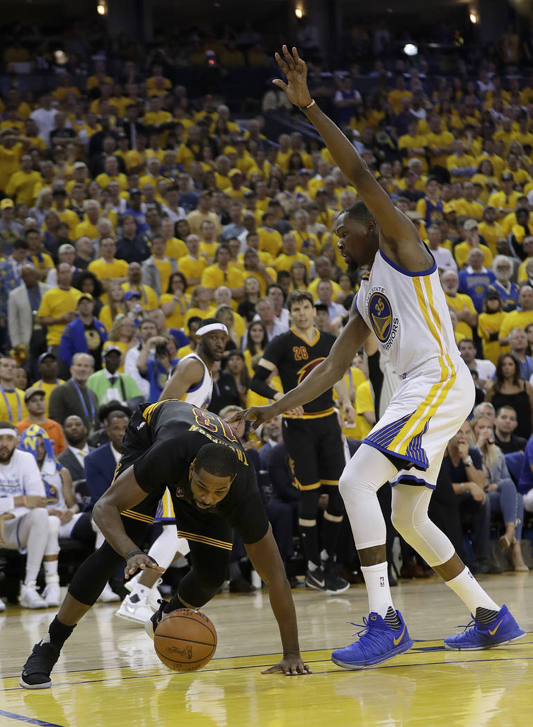 Cleveland Cavaliers center Tristan Thompson, left, is defended by Golden State Warriors forward Kevin Durant during the second half of Game 2 of basketball's NBA Finals in Oakland, Calif., Sunday, ...