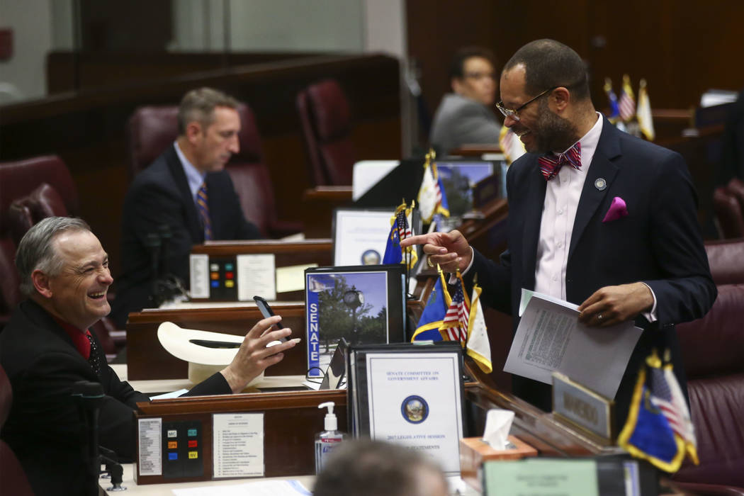 Sen. James Settelmeyer, R-Minden, left, and Senate Majority Leader Aaron Ford, D-Las Vegas, during the final hours of the Nevada Legislature at the Legislative Building in Carson City on Monday, J ...