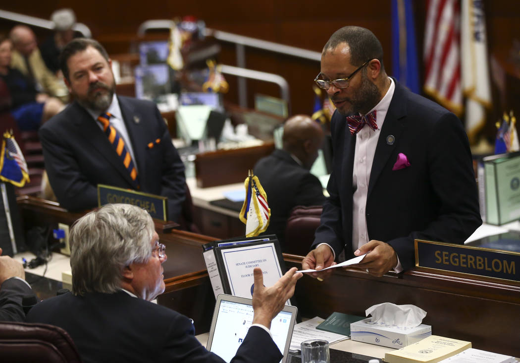 Sen. Tick Segerblom, D-Las Vegas, and Senate Majority Leader Aaron Ford, D-Las Vegas, during the final hour of the Nevada Legislature at the Legislative Building in Carson City on Monday, June 5,  ...