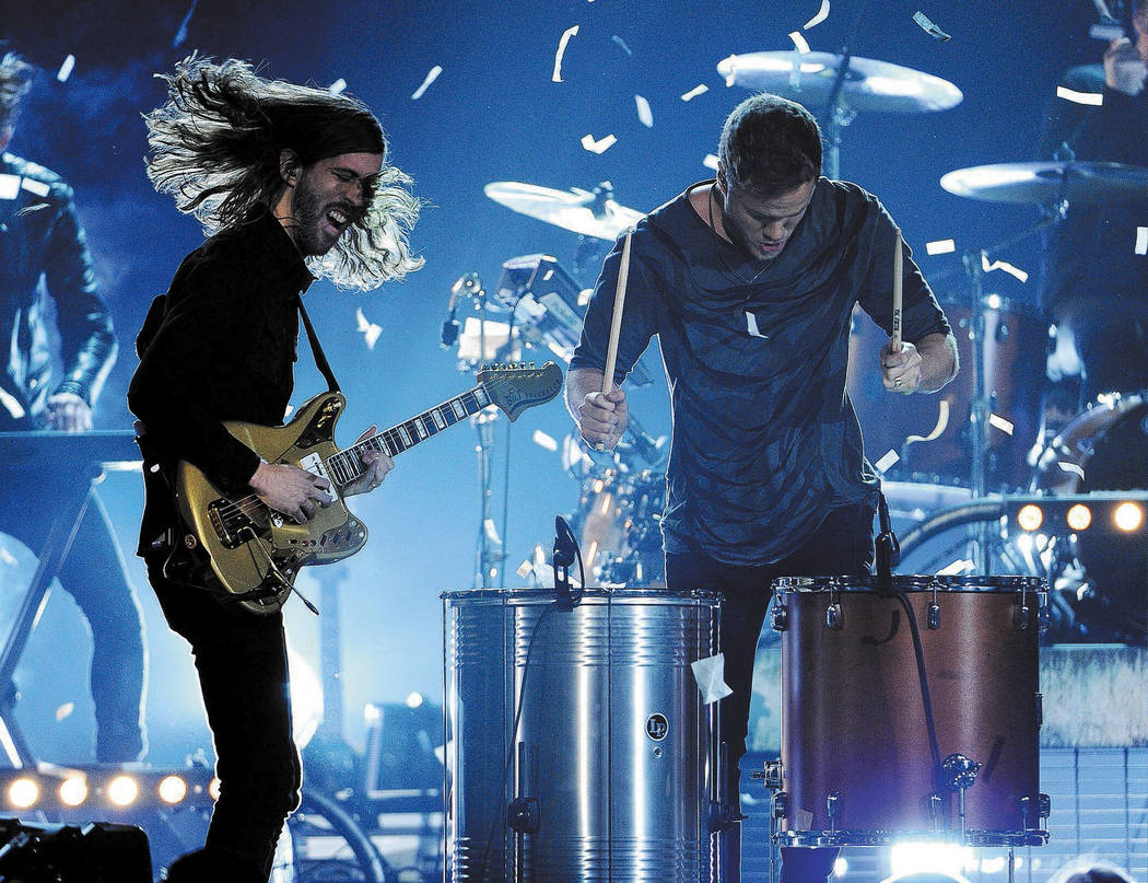 Wayne Sermon, left, and Dan Reynolds, of the musical group Imagine Dragons, perform on stage at the Billboard Music Awards at the MGM Grand Garden Arena on Sunday, May 18, 2014, in Las Vegas. (Pho ...