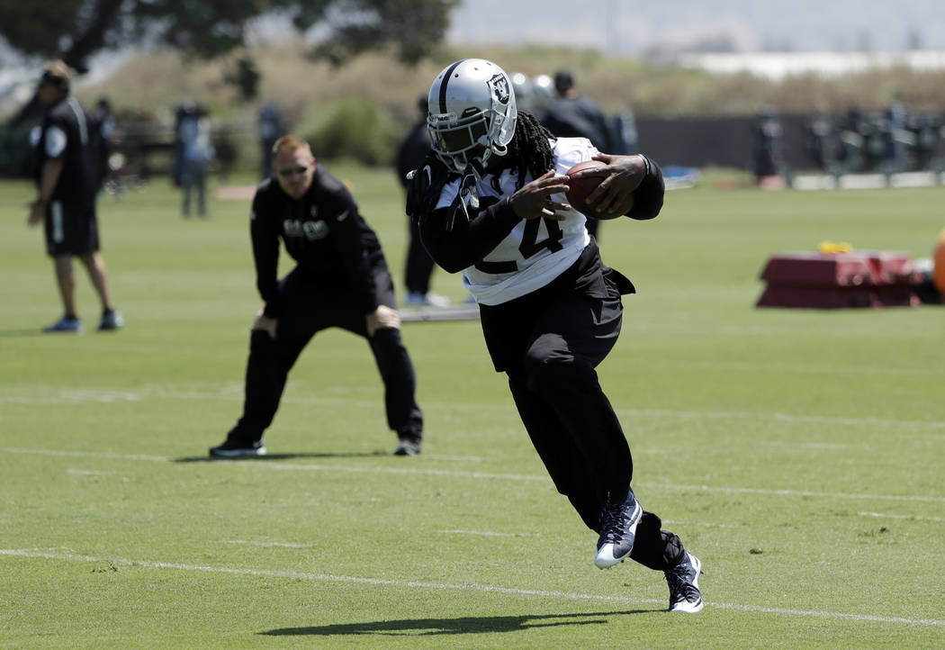 Oakland Raiders running back Marshawn Lynch runs after a catch during the team's organized team activity at its NFL football training facility Tuesday, June 6, 2017, in Alameda, Calif. (AP Photo/M ...