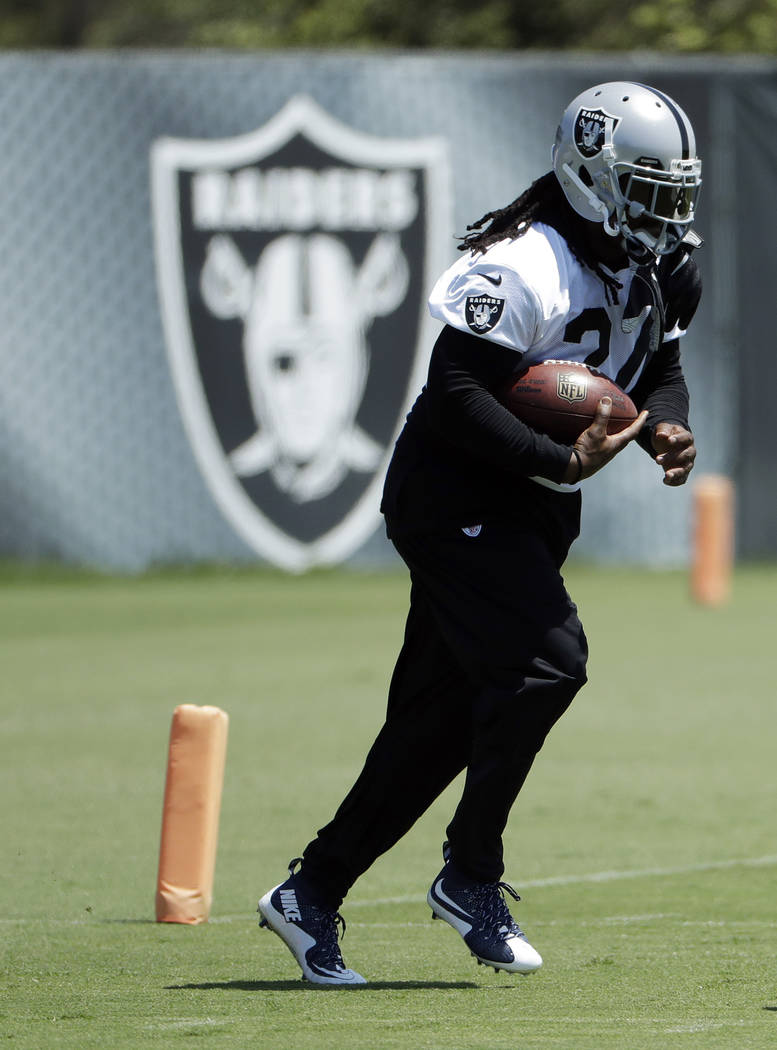 Oakland Raiders running back Marshawn Lynch participates in drills during the team's organized team activity at its NFL football training facility Tuesday, June 6, 2017, in Alameda, Calif. (AP Pho ...