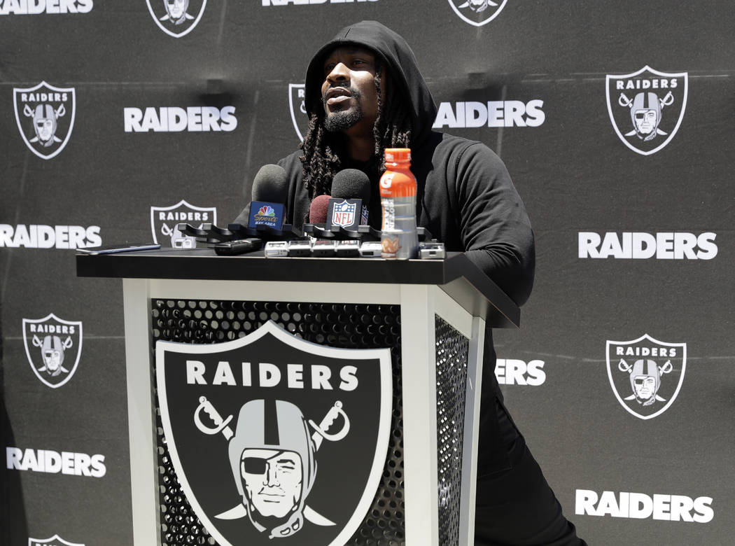 Oakland Raiders running back Marshawn Lynch fields questions after the team's organized team activity at its NFL football training facility Tuesday, June 6, 2017, in Alameda, Calif. (AP Photo/Marc ...
