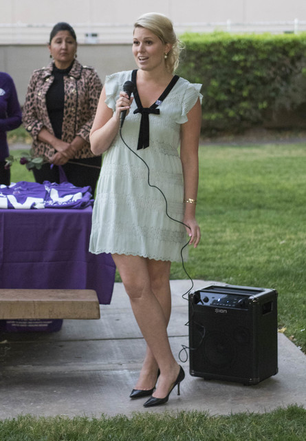 Kathryn Carr, director of national outreach for Marsy's Law For All, speaks during a candlelight vigil memorial honoring domestic violence victims hosted by SAFE House at Proctor Park in Henderson ...