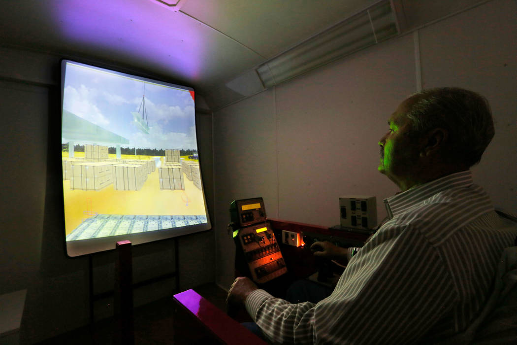 Louis Loupias, coordinator of the Southern Nevada Operating Engineers JATC, demonstrates a crane training simulator at William C. Waggoner Training Center in Las Vegas, Wednesday, May 24, 2017. Ch ...