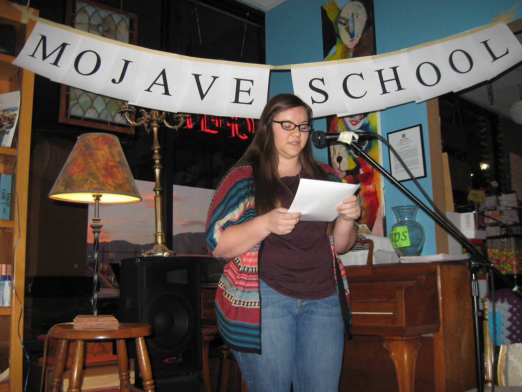 A student reads her work at the end of the Mojave School writing workshop in Pahrump in 2013. The Mojave School