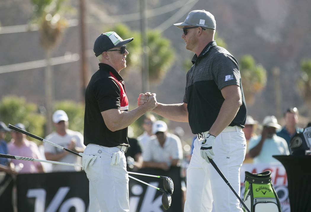 "Dan McIntosh, left, shakes hands with Tim Burke, right, after they compete in the semi-final qualifier at the World Long Drive Association's ""Clash in the Canyon"" at Mesquite Reg ..."