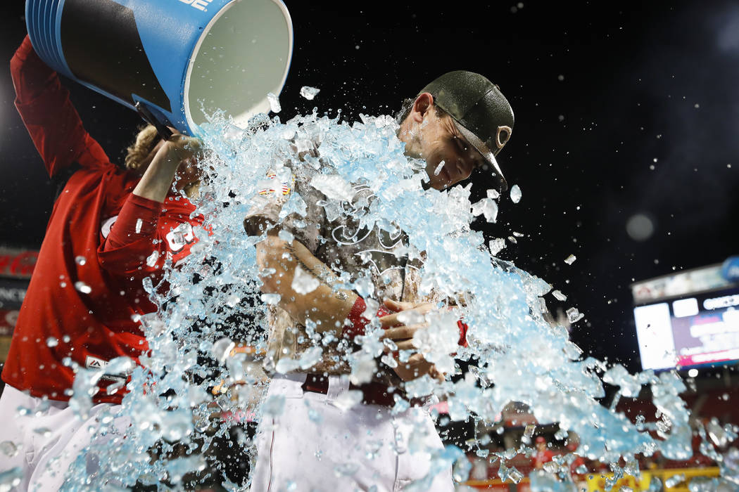Cincinnati Reds' Scooter Gennett is dunked after a baseball game against the St. Louis Cardinals, Tuesday, June 6, 2017, in Cincinnati. The Reds won 13-1. Gennett recorded four home runs, includin ...
